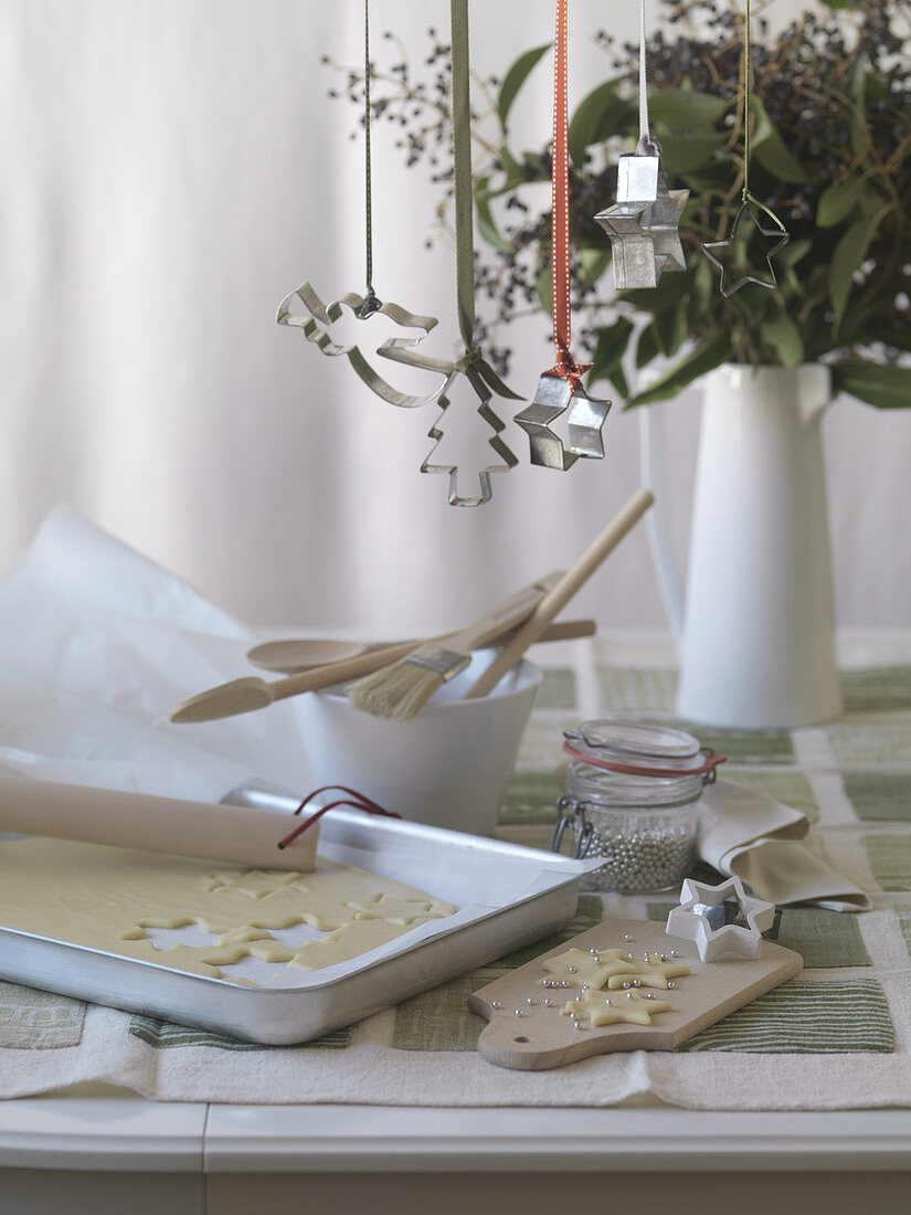 Baking scene with biscuit dough and baking utensils