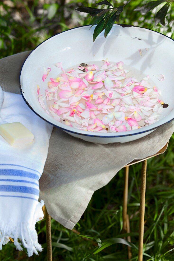 Bowl of water and rose petals