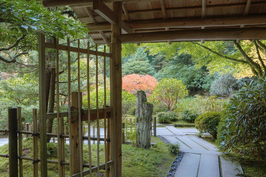 Covered area with bamboo gate and fence in the Japanese Tea Garden in Portland