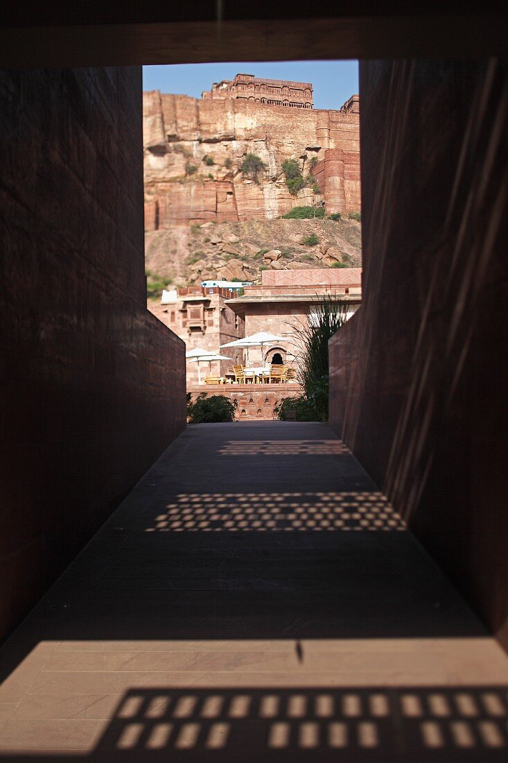 Paved corridor with view of mountain fortress in Raas Haveli Hotel, Jodhpur, India