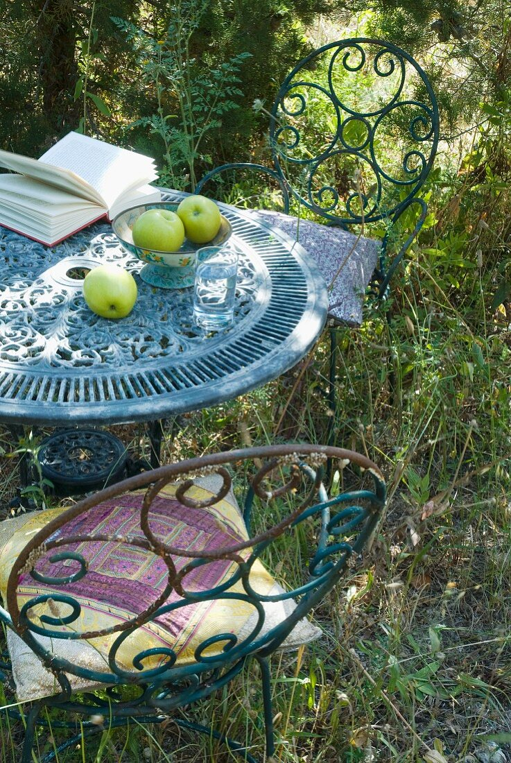 Vintage garden table and chairs made of rusty metal