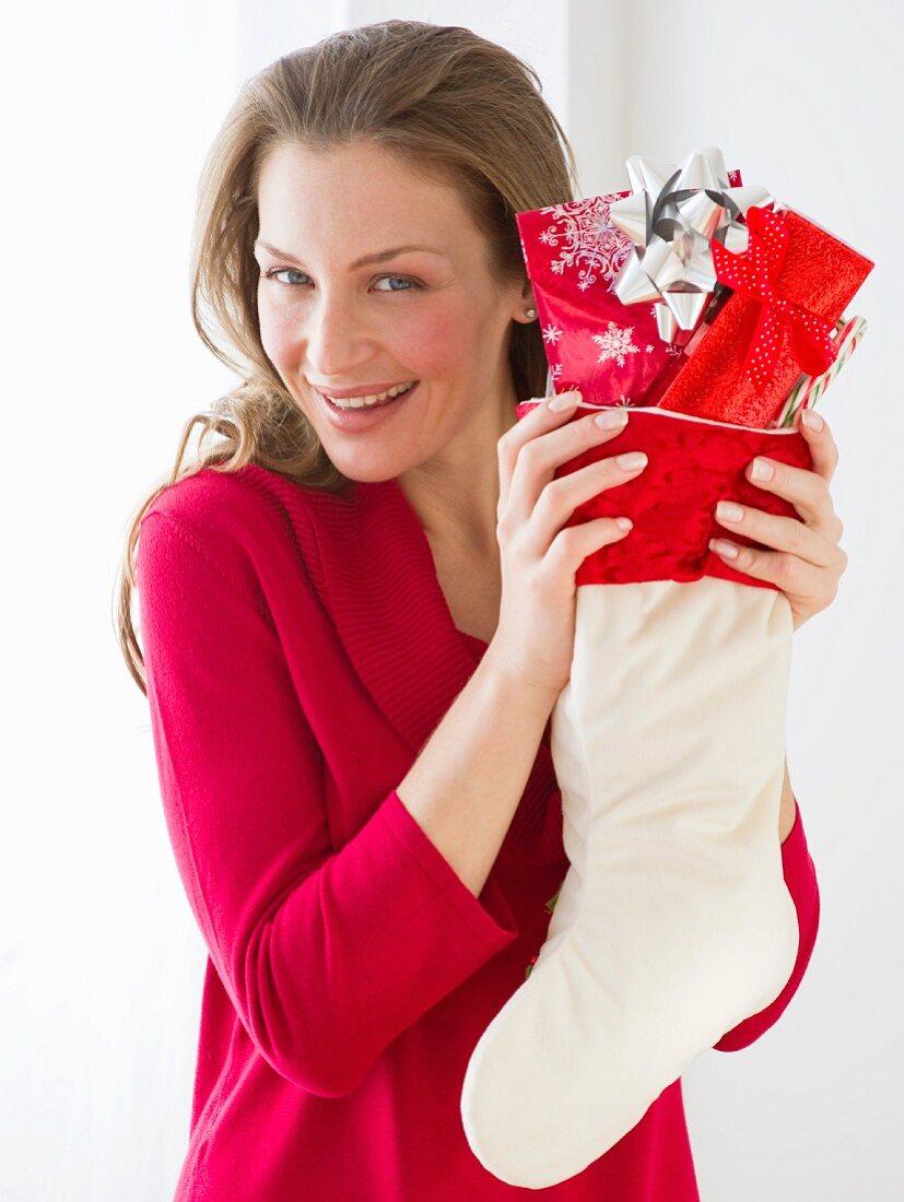 Woman holding Christmas stocking