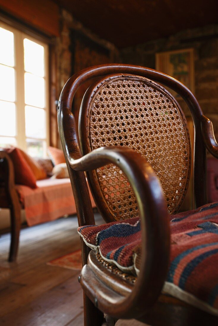 Thonet bentwood chair with cane back in interior