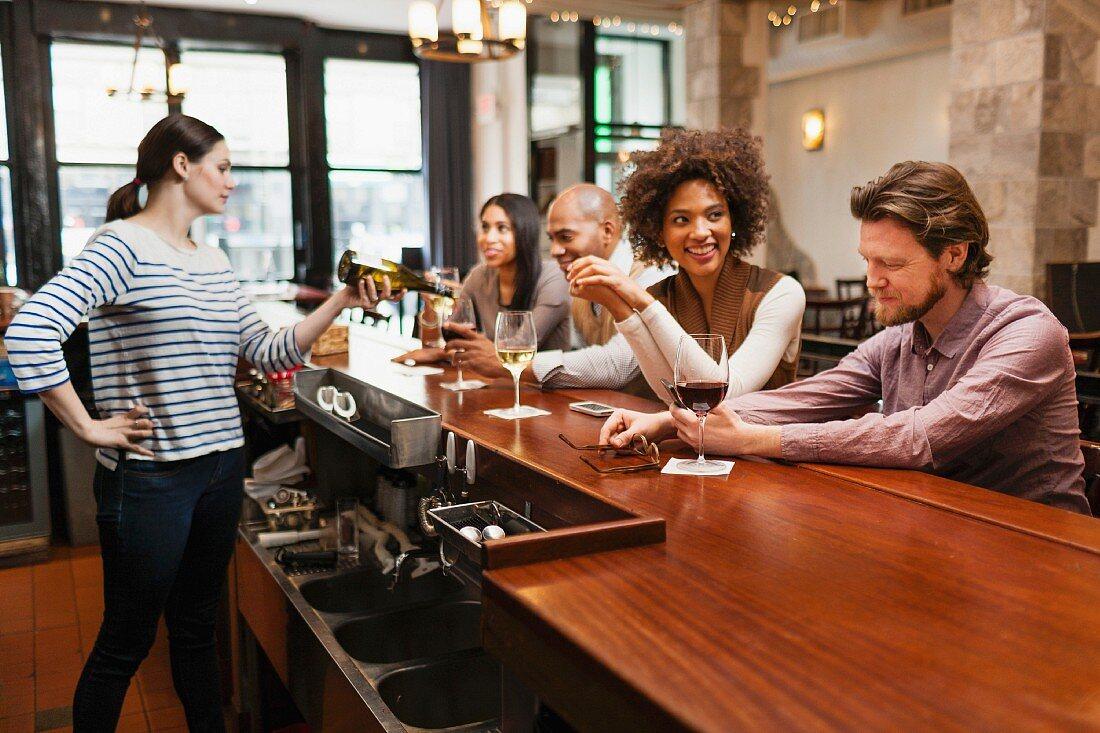 Customers drinking at bar