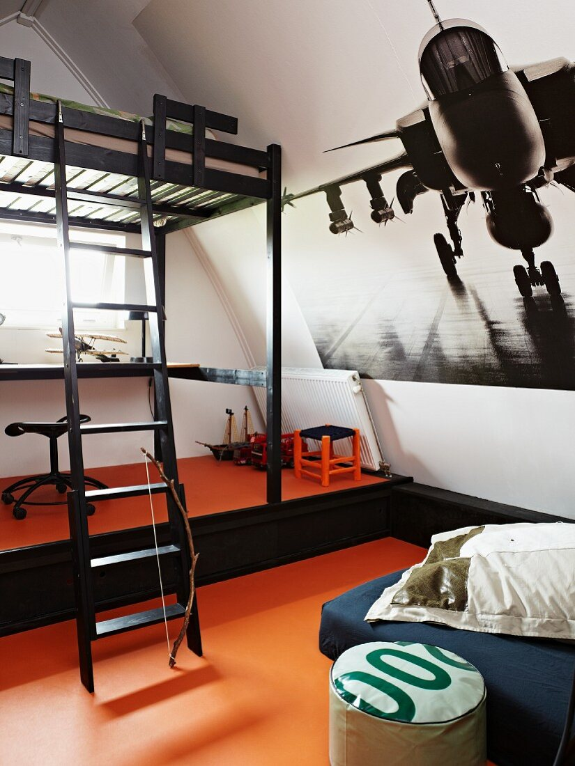 Child's attic bedroom with large aeroplane poster on sloping wall