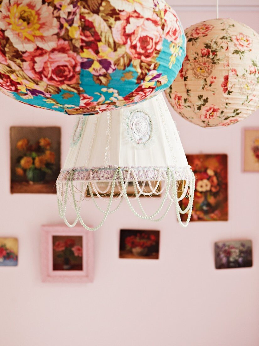 Colourful paper lanterns with patterns of roses