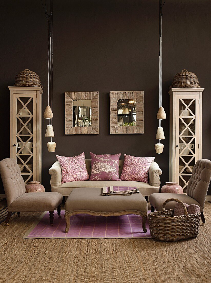 Living room in natural shades with dark brown wall; pink scatter cushions and lilac rug add cheerful touches