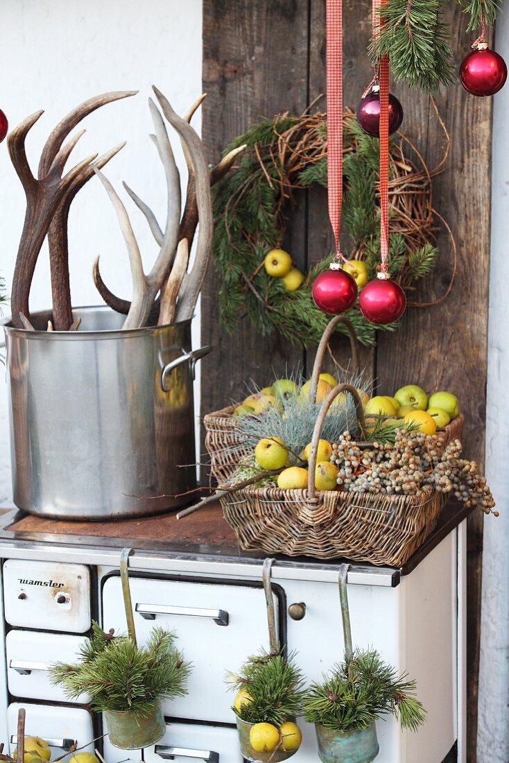 Rustic winter arrangement on top of old wood-burning cooker