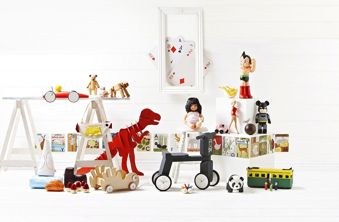 Toy still life with dinosaurs and tricycle