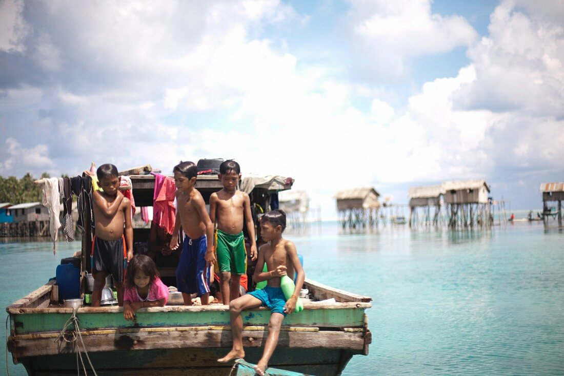Children Playing at Back of Boat, Semporna, Borneo