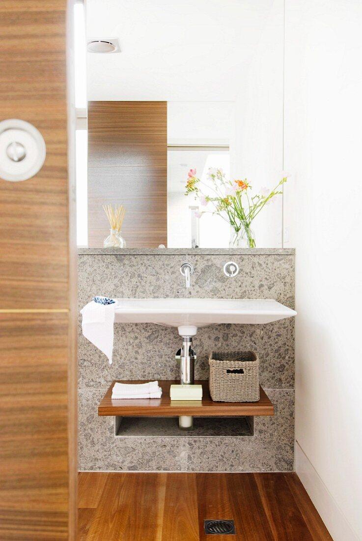 Mirror and elegant washstand in designer bathroom