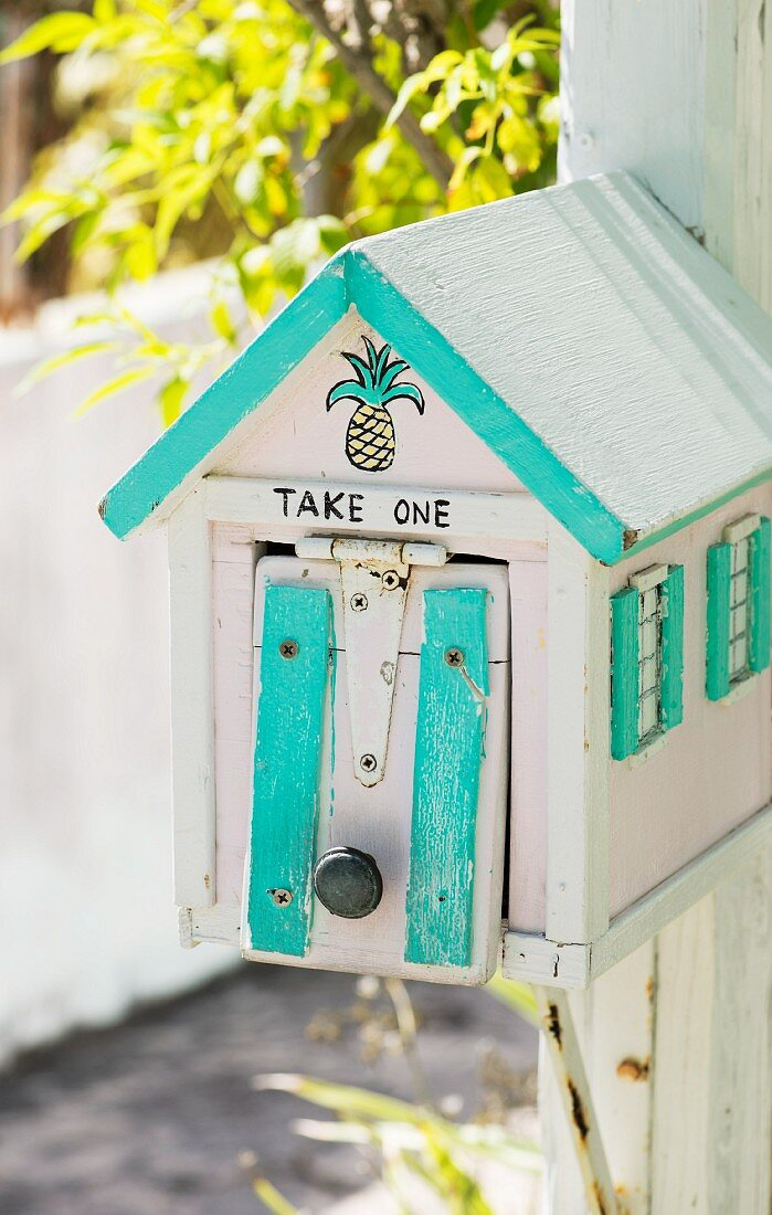 Painted letterbox outside house