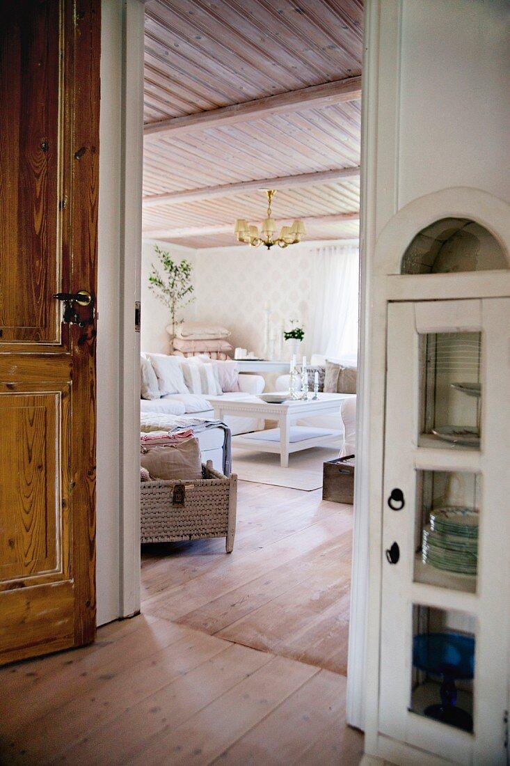 Half-height, narrow cabinet next to open door with view into living room