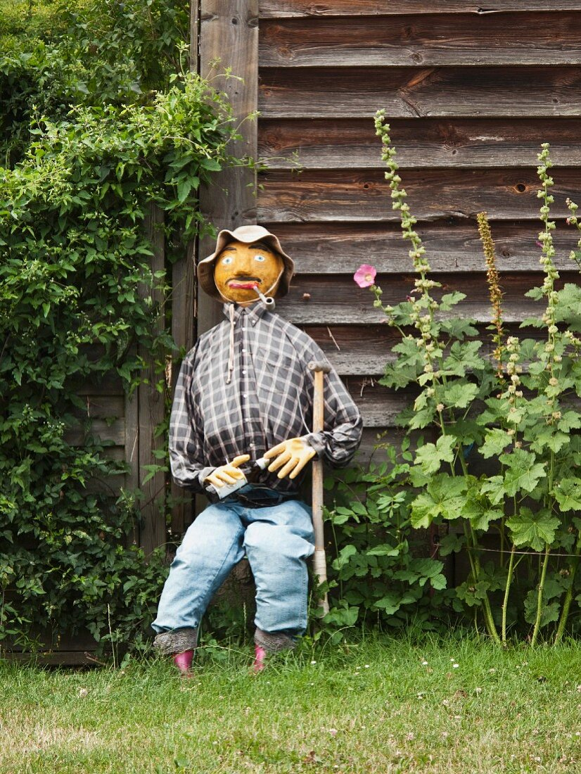 Seated scarecrow