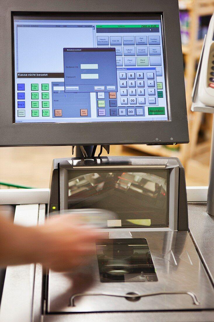 Scanning groceries at a supermarket