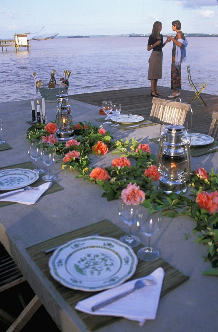 A festively laid table by the sea