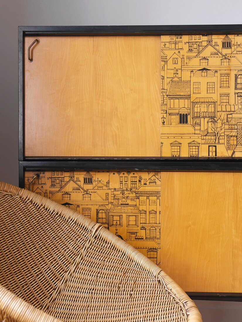 Bamboo armchair in front of cabinet