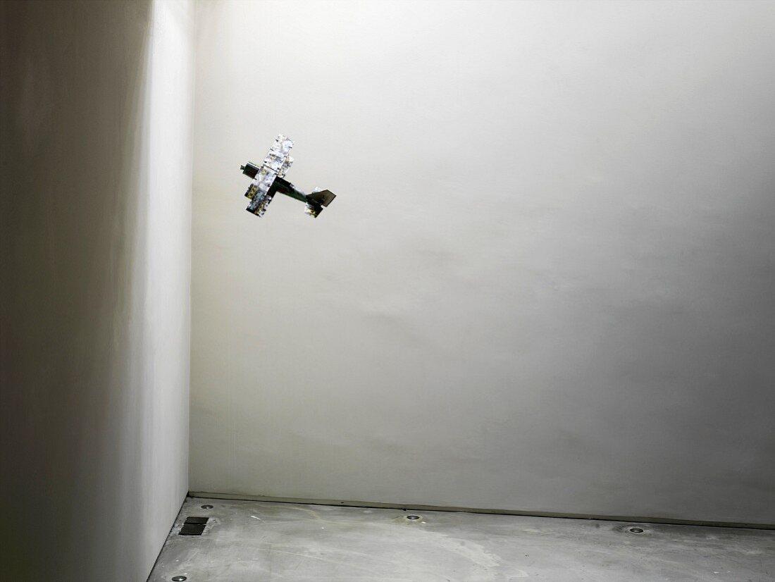 Model aeroplane hanging in corner