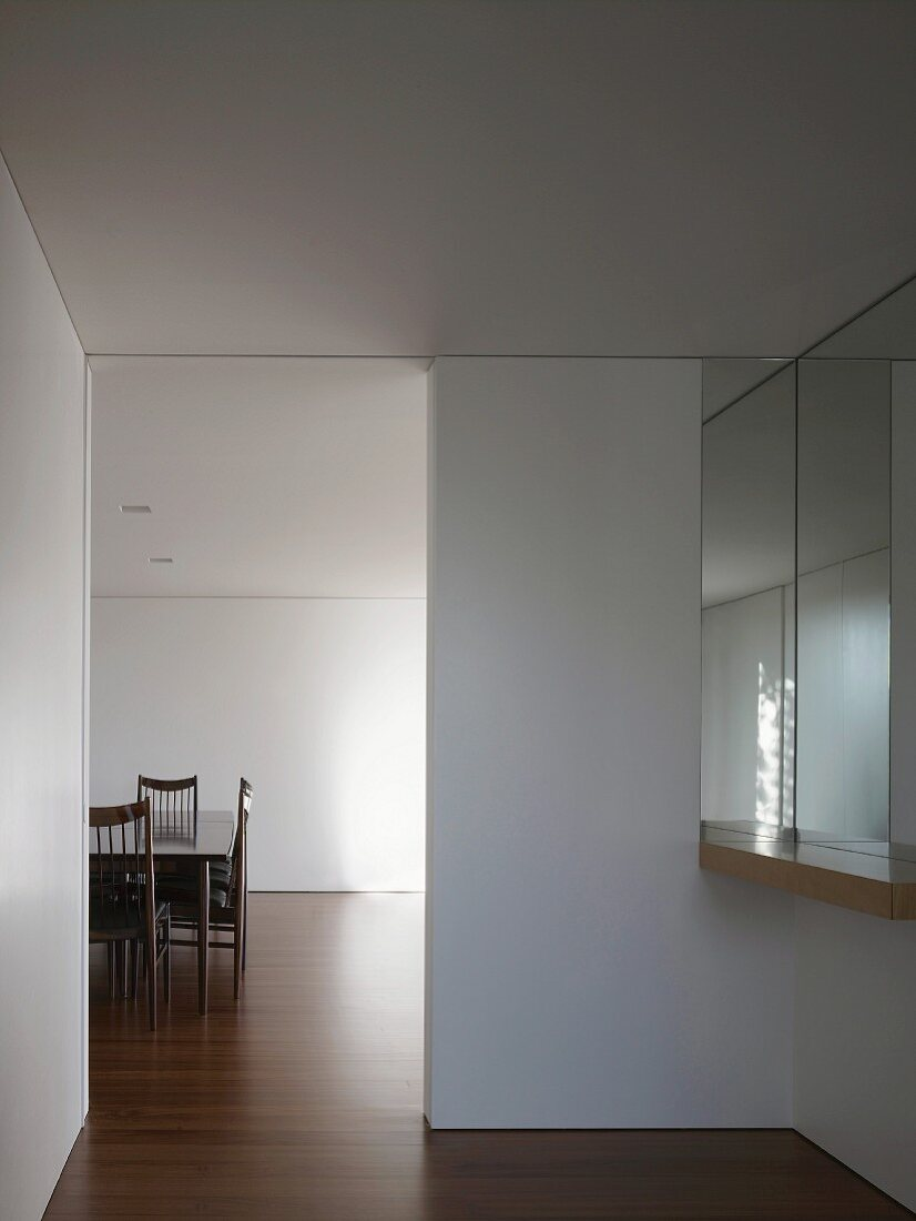 View into living space with table & chairs