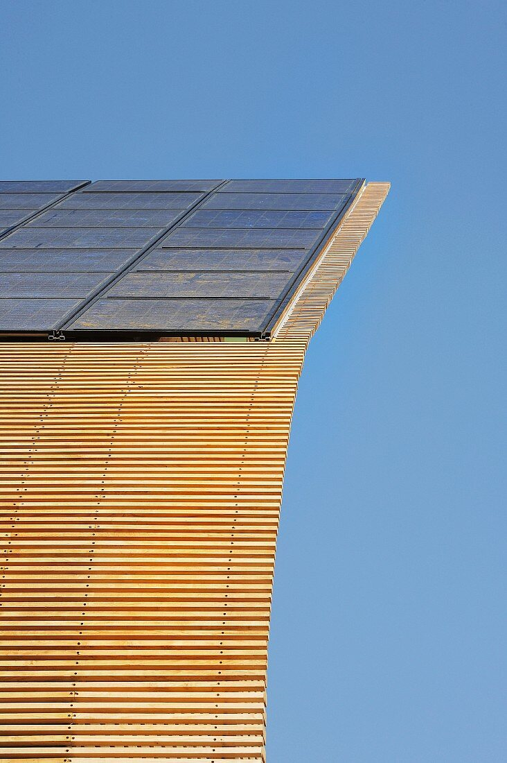 Solar panels on wooden structure of ecological house