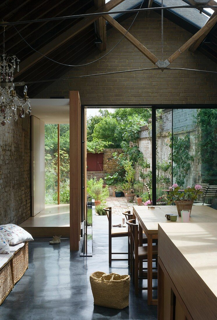 Living space with dining area & view of terrace & courtyard