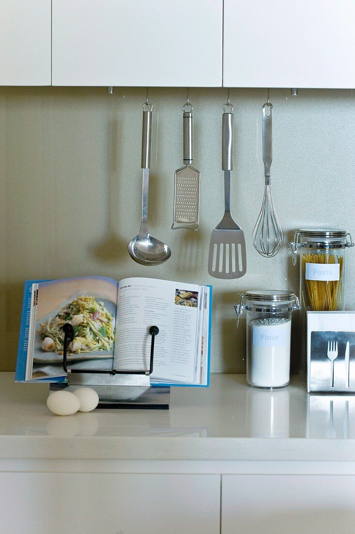 Kitchen Utensils And Open Cookbook On A Buy Image 11027966 Living4media