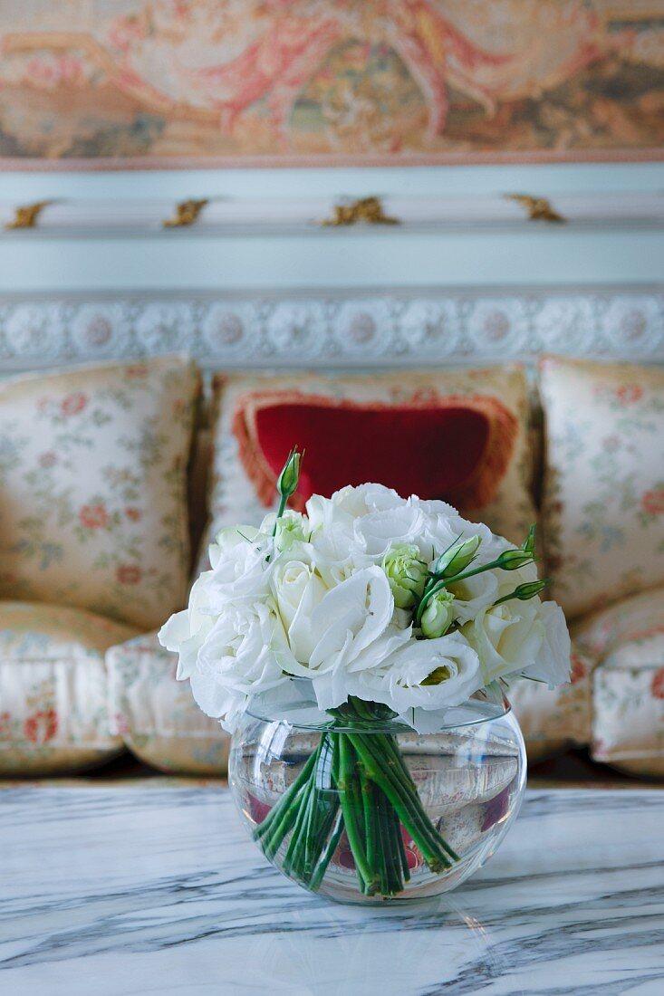 Flower arrangement on marble table