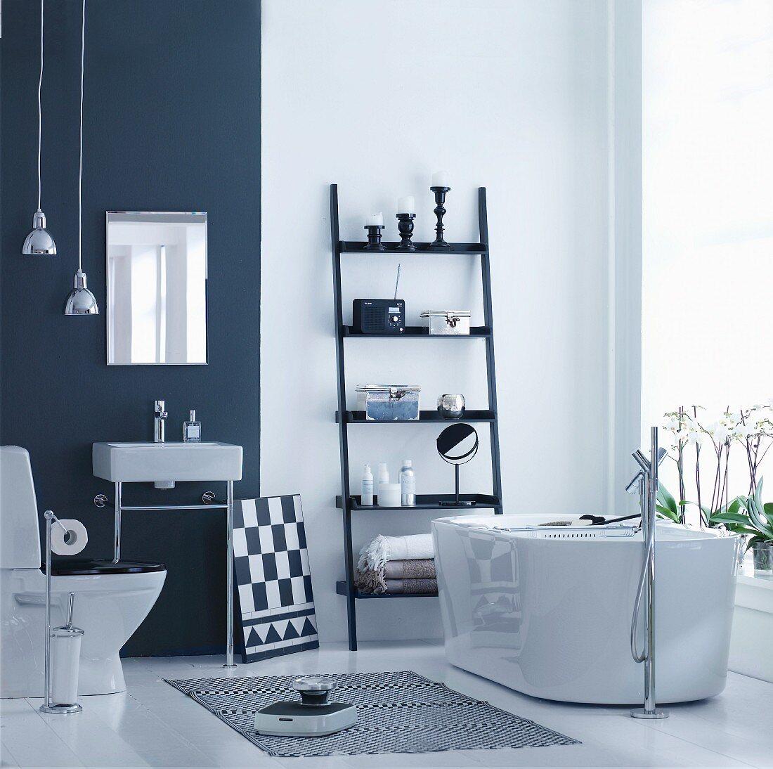 Black and white designer bathroom with free-standing bathtub
