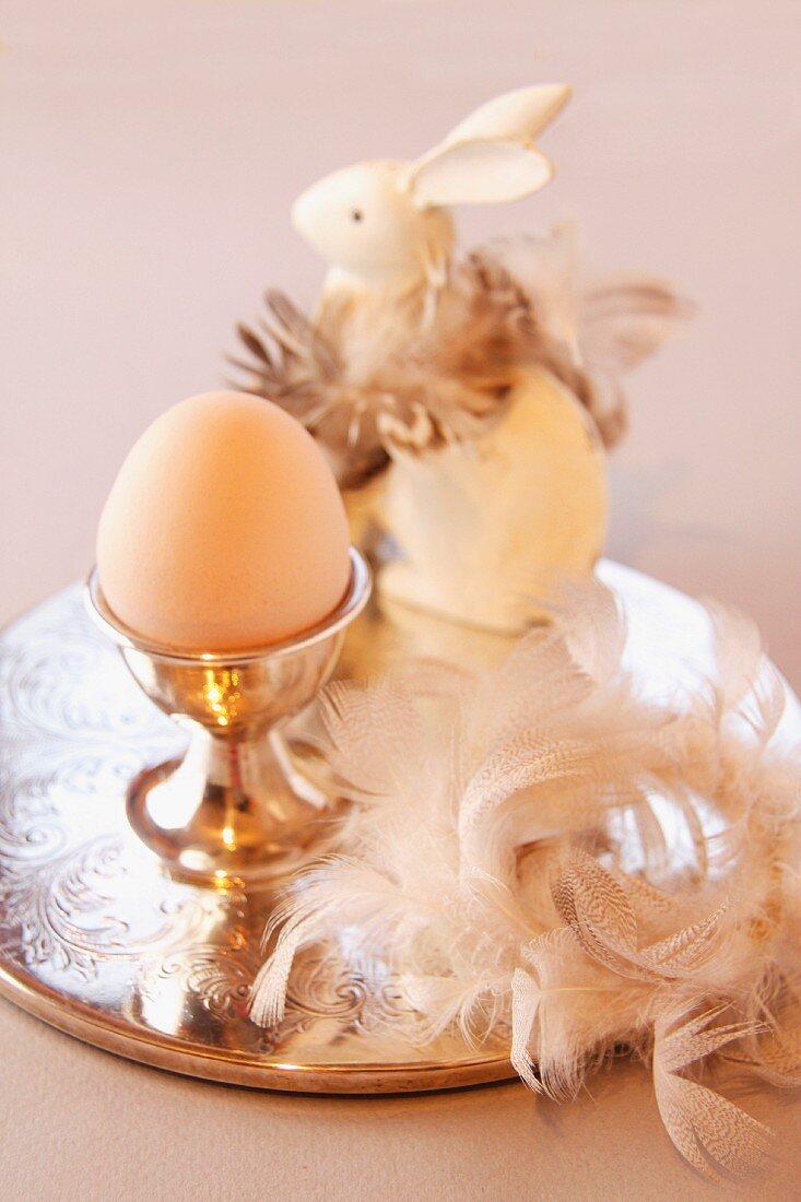 An elegant Easter arrangement featuring an egg and a rabbit