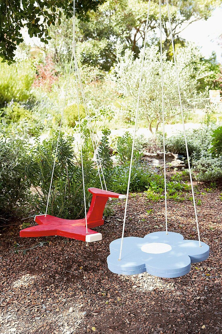Home-made swings in the shape of an aeroplane and flower