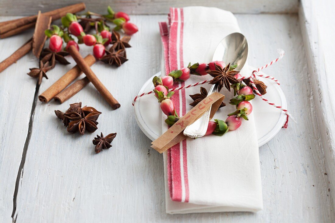 Place setting with small wreath of St. John's wort berries