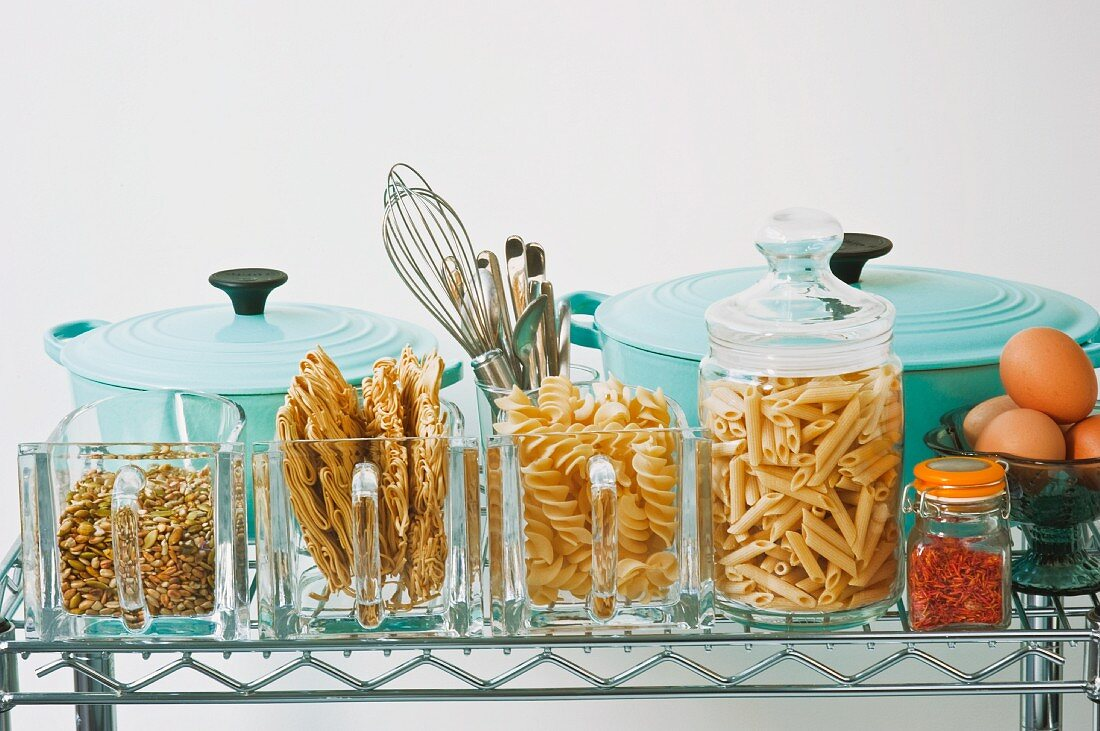 Pots and storage containers for pasta on a shelf