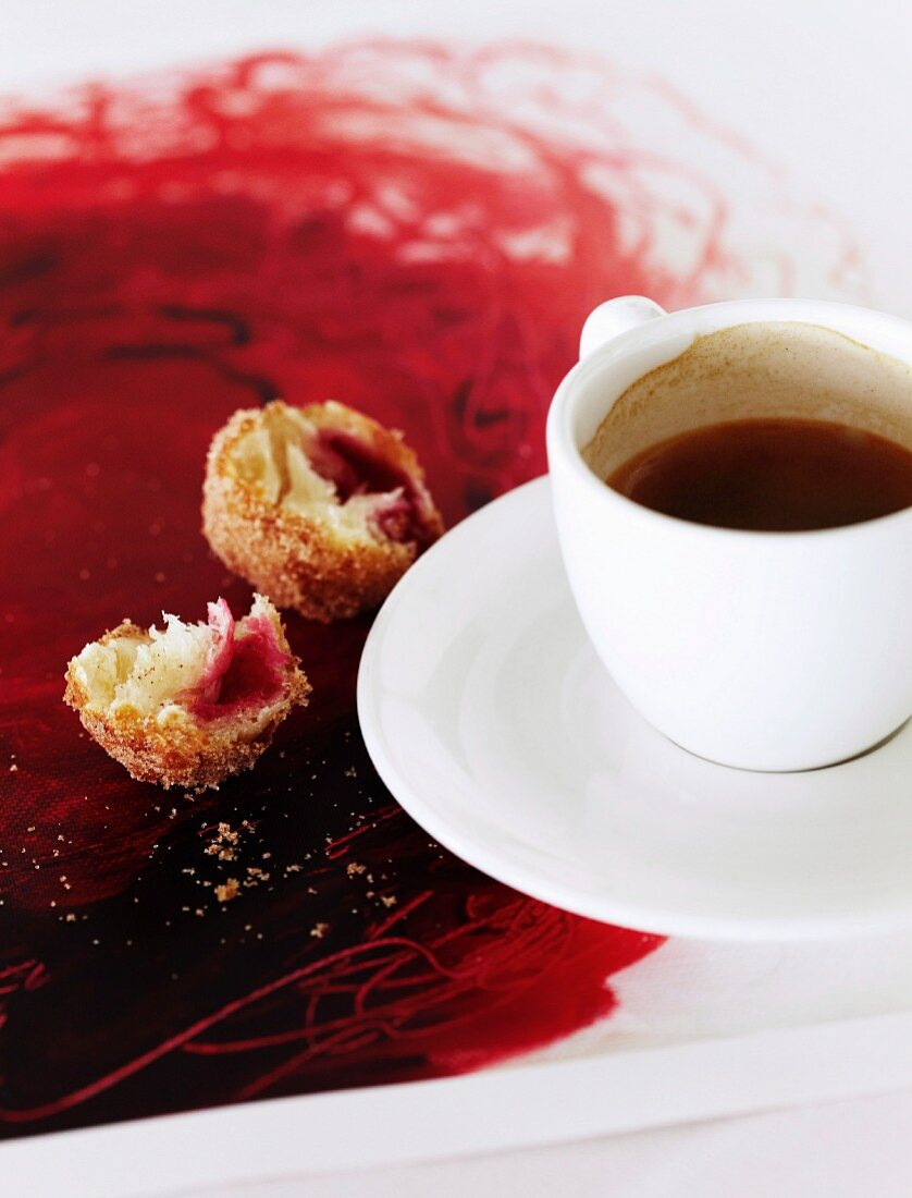 Espresso break - cup of espresso next to crumbs of cake on painted tray