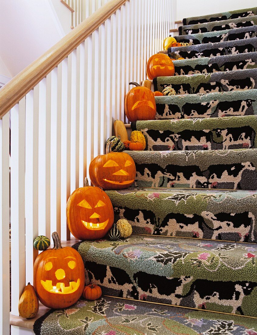 Staircase with whimsical runner and Halloween decoration on every step