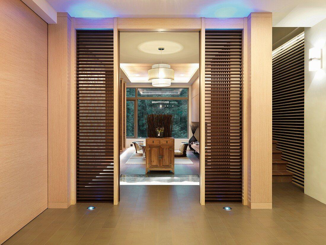 Doorway to modern oriental dining room