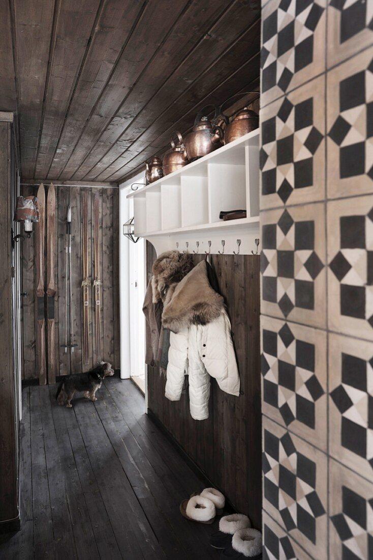 Rustic hallway with dark board floor, ceiling and walls