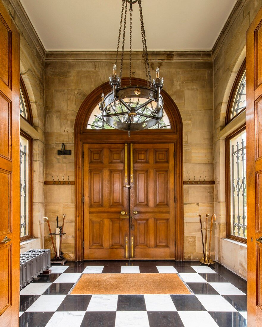 Double doors and exposed stone walls in grand foyer