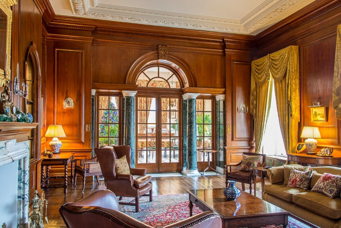 Grand interior with panelled walls and marble pillars
