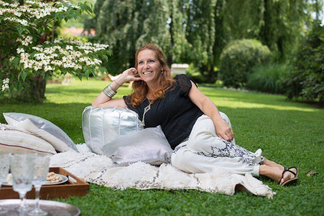 Woman enjoying Oriental picnic in garden