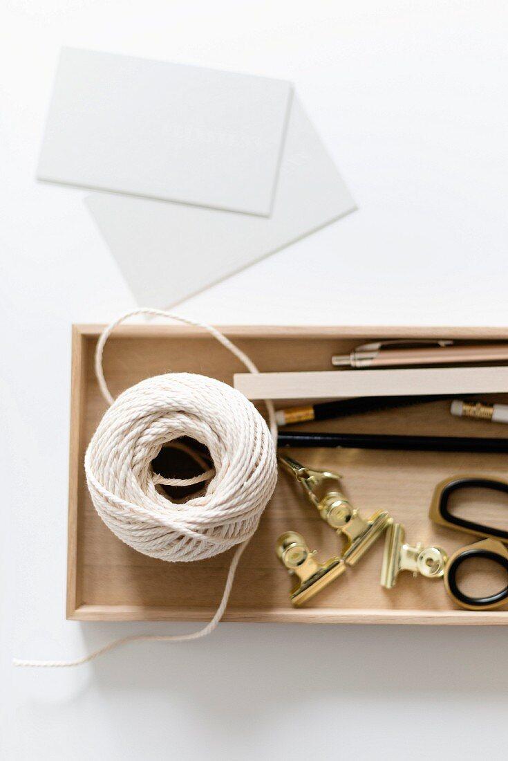 Office utensils in wooden box
