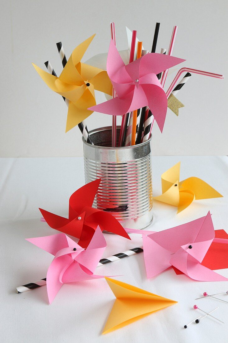 Hand-made origami windmills standing in tin can