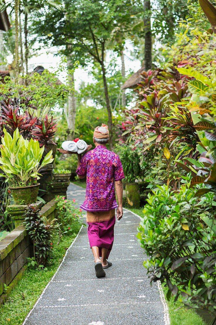 Balinese man walking along path