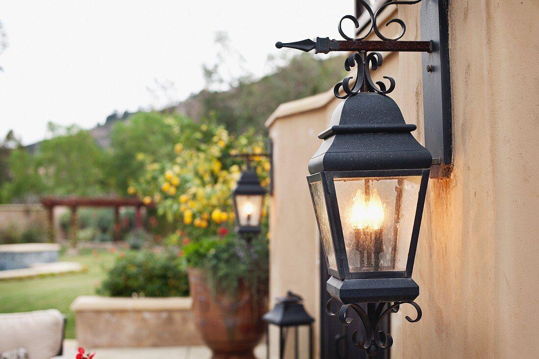 Close-up of a lit lantern mounted on wall; Rancho Sante Fe; USA