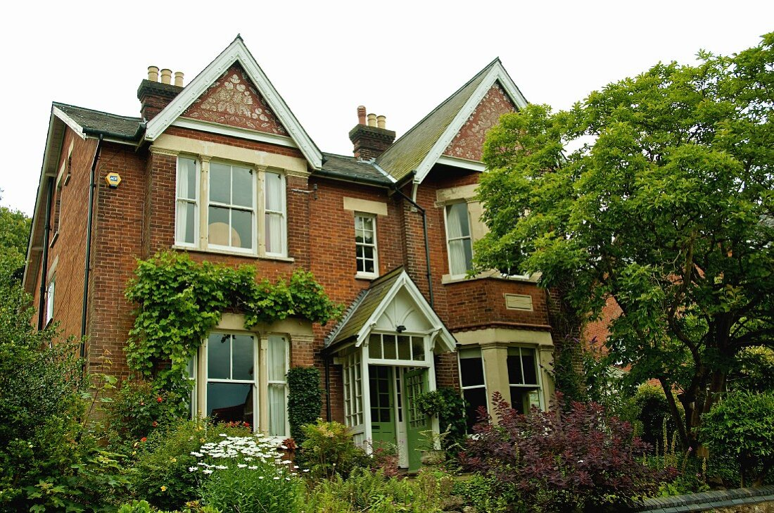 Victorian house built around 1886 with front gables and English brick facade