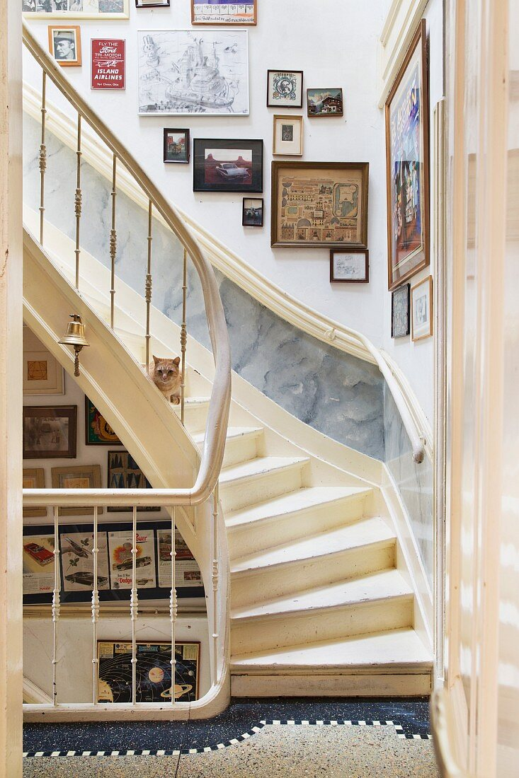 Staircase with cream wooden staircase and gallery of pictures on wall