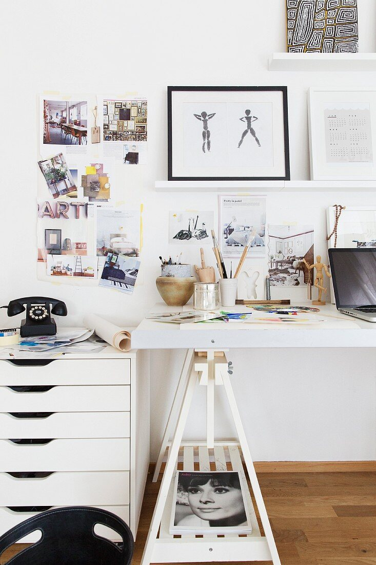 White filing cabinet with drawers next to desk on trestles in home office