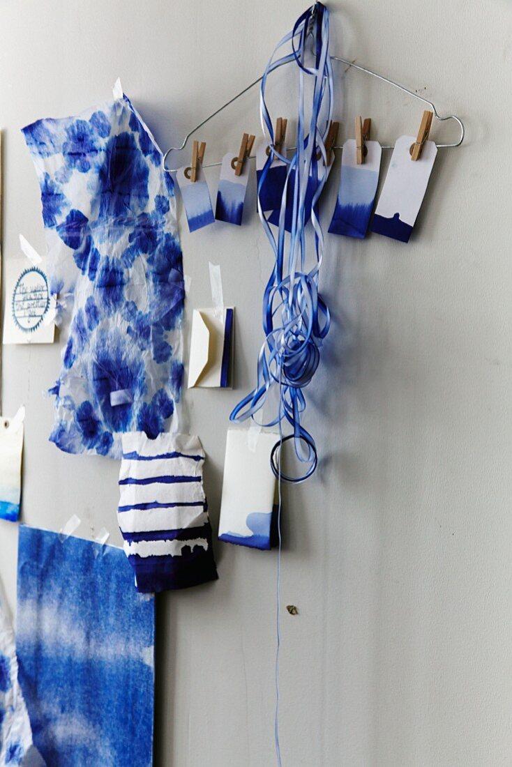Batik fabrics, dip-dye gift tags and ribbons stuck on wall