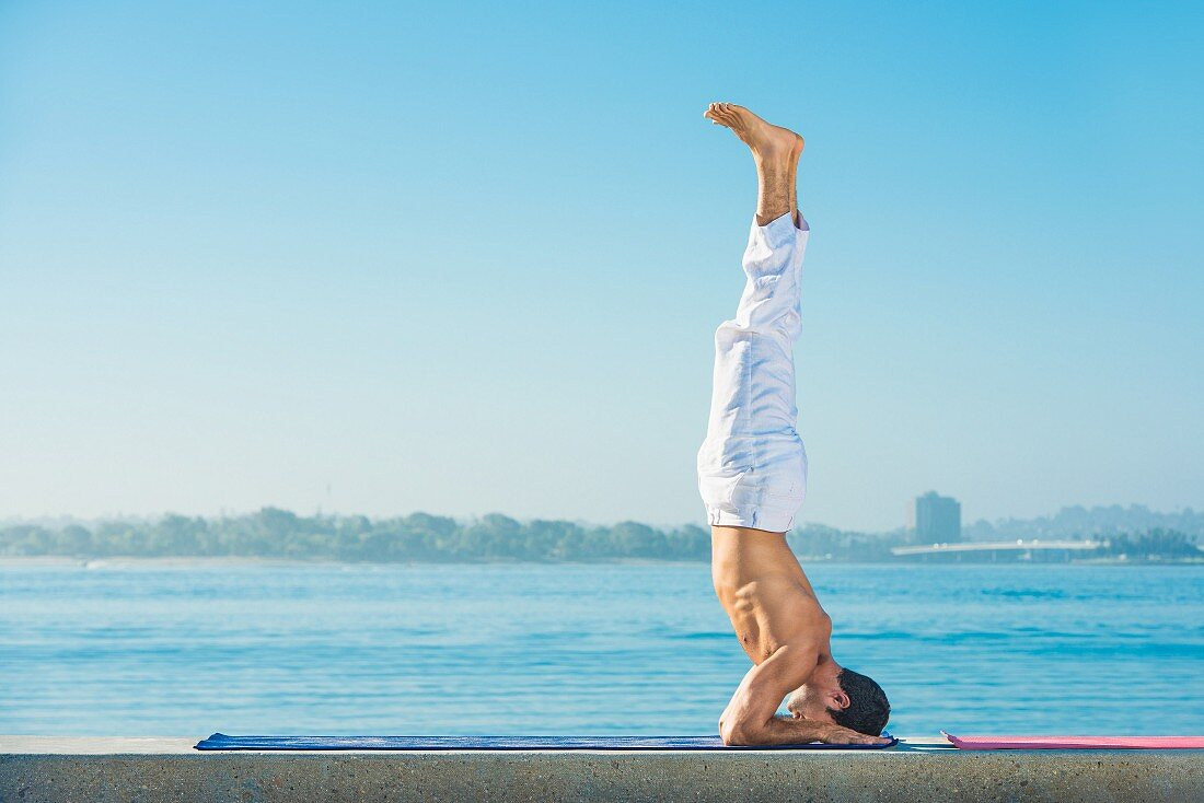 A headstand by the sea