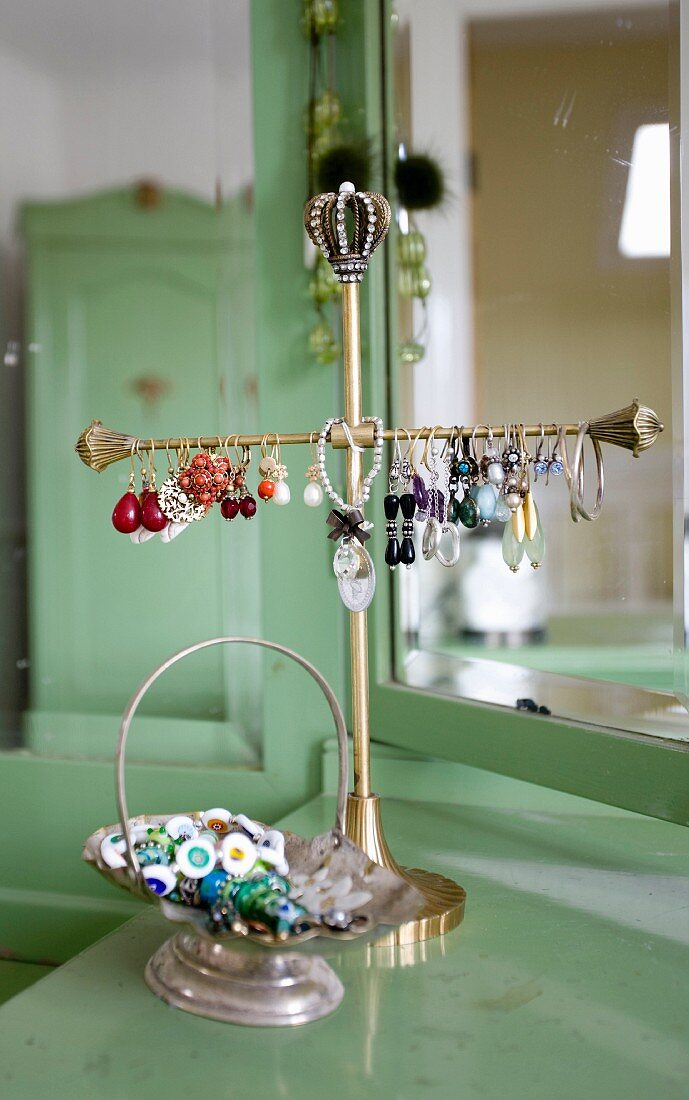 Earrings on brass jewellery stand