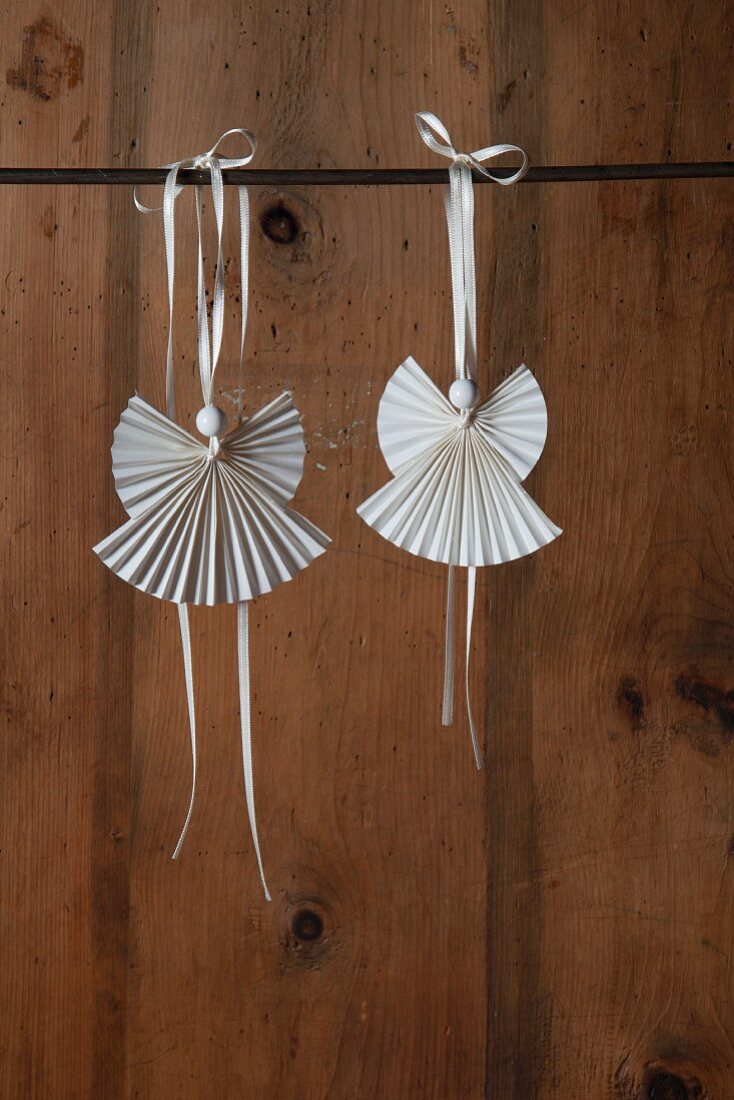 Angel pendants made from folded paper